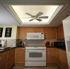 changing the kitchen fluorescent box light fixtures. like the use