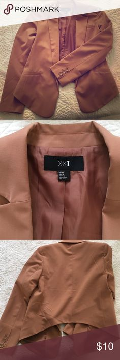 Light pink blazer. Hi low style. Forever 21 blazer. It is kind of a khaki pink color. No front closure. Three button accent on sleeves. Forever 21 Jackets & Coats Blazers