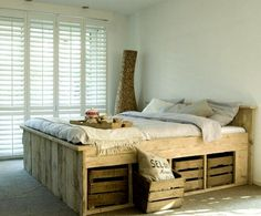15 beautiful examples of bed frames made from discarded wood pallets.
