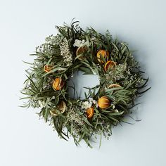 Citrus Wreath - It's a beautiful circle made of spiral and willow eucalyptus, and adorned with slit oranges, and dried orange and lemon slices.