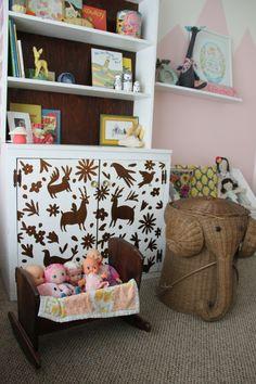 A boho chic shared nursery.