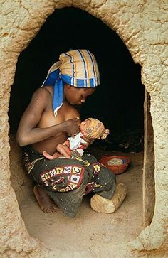 This is a beautiful breastfeeding picture. The way she looks at her child...