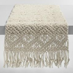 Intricately hand knotted by Indian artisans of 100% cotton with long tassels, our exclusive natural macrame runner adds bohemian flair to the table.