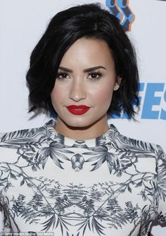 Dolled up: Demi wore her signature crimson red lipstick at the fan meet and greet...