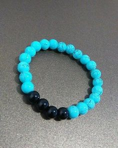 Black and light blue glass beads stretch bracelet