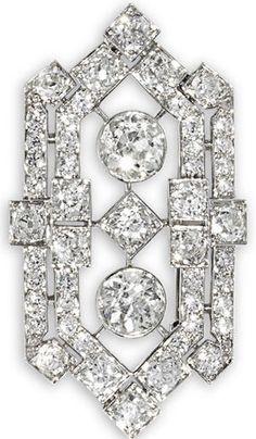 An Art Deco diamond brooch/pendant, circa 1930. The lozenge-shaped openwork plaque of pierced geometric design, set throughout with old brilliant-cut diamonds, principal diamonds approximately 1.70 and 1.40 carats, remaining diamonds approximately 4.80 carats total, pendant length 5.0cm. #ArtDeco #brooch #pendant