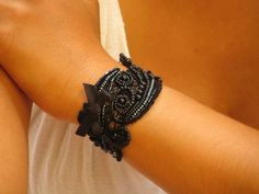 Hand embroidered beads on vintage lace w/ vintage button and elastic loop closure.  $95.00 from Carellya Etsy Shop.