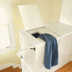 A built-in laundry chute opens at the crossroads between bedrooms and a bath and empties into the basement at the foot of the washing machine. |  Photo: Alex Hayden | thisoldhouse.com