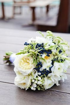 White and navy blue wedding bouquet ...I like the pop of navy for me, since I'll be in white :) then white or white/green for bridesmaids!