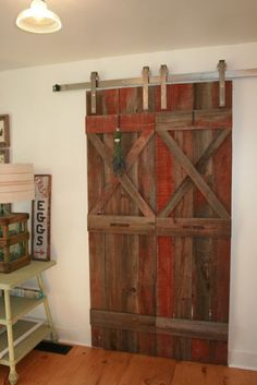 These are two of the nicest barn doors I've seen- love the pop of color.