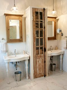 For the bathroom of a longtime customer-turned-friend, designer Katie Gagnon created a unique storage unit for the space between a pair of pedestal sinks. The storage cabinet was custom made while the door is a vintage salvaged piece. Vintage Bathroom Cabinet, Vintage Bathrooms, Bathroom Wall, Modern Bathroom, Bathroom Vanities, Chic Bathrooms, Pedestal Sink Bathroom, Bathroom Furniture, 1920s Bathroom