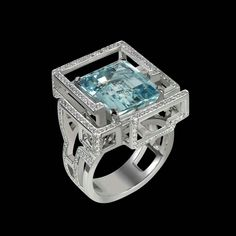 Lorenz Baumer Labyrinth ring set in white gold featuring diamonds and a centre aquamarine.