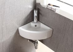 Complement your bath or powder room by adding this Elanti Wall-Mounted Corner Bathroom Sink in White. Made of porcelain material. Corner Sink Bathroom, Corner Vanity, Compact Bathroom, Glass Sink, Little Corner, Corner Wall, Home Upgrades, Bathroom Inspiration, Bathroom Ideas