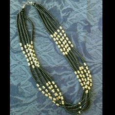 Beautiful Black and Gold 5 strand necklace 5 strands of black and gold plastic beads. I bought this at an estate sale it is in great condition. Fashion jewelry at its best. Looks new Jewelry Necklaces