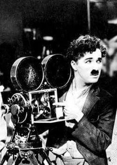 Charlie Chaplin during the filming of Sunnyside (1919).