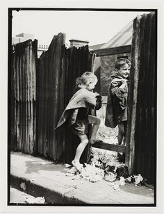 Children in Sydney slums, mainly Surry Hills, Woolloomooloo, Redfern, 1949 by Ted Hood by State Library of New South Wales collection, via Flickr