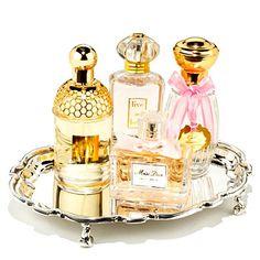 Perfume display on silver platter.