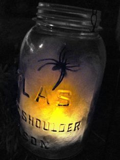Make your own spider web jar with batting or faux spider web, plastic spider, LED tea light, wire, and wire cutters
