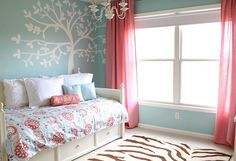 I love the sky blue and coral colors together!  This would be PERFECT for the guest bedroom!! -- If Chase doesn't think it's too 'girly'.