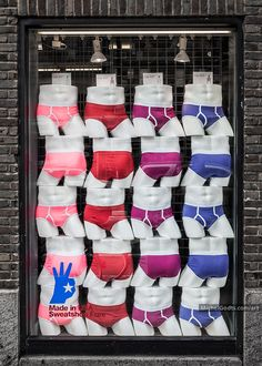 Men's Underwear On Display :: Fine Art Urban Photograph For Sale — Buy this original fine art photography by Michel Godts. A store's window in Chelsea, NY, with 20 mannequins wearing men's briefs.