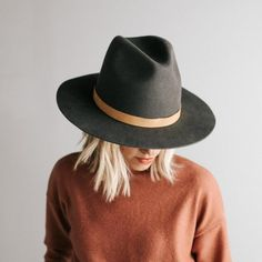 """The Billie is a tall crown hat with a structured, tall crown and stiff brim. This tall crown fedora features a crown height of 5.5"""" and a brim width of 3.5"""". The Billie tall fedora hat is available in 57 S/M and 59 M/L and features an adjustable inner band and also comes in Ivory and Black. Our removable leather bands look great on the Billie, check them out here. For hat sizing tips check out our hat sizing guide here."""