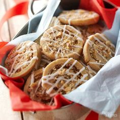 A crunchy-sweet swirl of mixed nuts, brown sugar, and cinnamon dresses up basic cookie dough. Vanilla glaze adds a festive holiday touch./