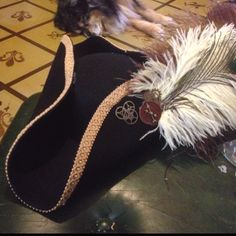 Homemade steampunk pirate hat with gears and feathers