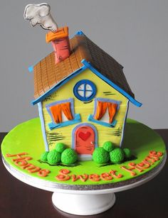 A colourful house warming cake for new home owners