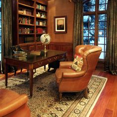 A cozy chair is better by a lamp than a working surface.  Decorating inspiration for your study  - GoodHousekeeping.com