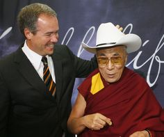 The Dalai Llama was once outfitted with a Stetson while visiting the Calgary  Stampede. 7ccc9520f8e1
