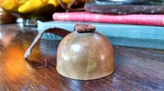 Antique Bell with Leather Strap Opened Mouth by TazamarazVintage