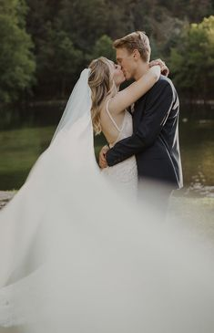 Wedding couple portrait with veil blowing in the wind | Image by Tressa Wixom Photography