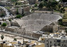The amphitheater at Philadelphia (currently known as) Amman, Jordan.  The hotel is practically in the parking lot. (chariots?)