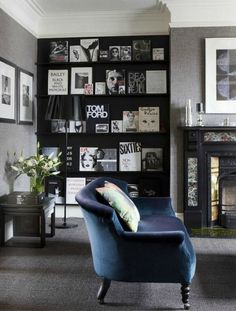A tone-on-tone living room. Deep blue sofa on a gray carpet, gray walls, Victorian fireplace, and modern bookcase make for an eclectic, fresh take on traditional design. My Living Room, Home And Living, Living Room Decor, Living Spaces, Bedroom Decor, Dining Room, Decoration Inspiration, Room Inspiration, Interior Inspiration
