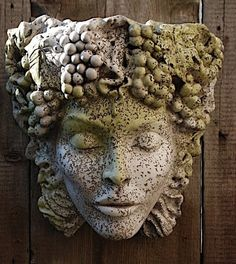 """This wall planter is so beautifully made to look like concrete it fools many!  Add it to your home or garden as an accent especially to watch the sun move across her face  accentutaing her classical features. The top of her head is open to plant.    6 lbs Lightweight concrete/resin  Actual dimensions 14.0""""W 8.5""""D 14.0""""H"""