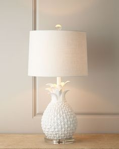 I love this pineapple lamp because of what this fruit represents in the South.  ;o)  Could be cute on foyer console.