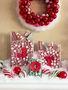 Holiday decorating - mantel with peppermint candy theme in red and white with pops of green.  Sparkly, colorful and festive! 50 gorgeous holiday mantel decorating ideas.