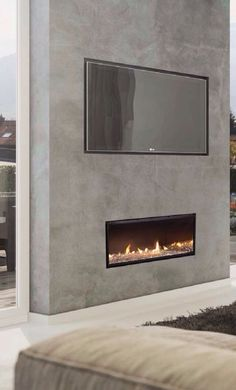 Check out the great deals we have running for the month of August, only at AmericanFireGlass.com 🔥 Fireplace Feature Wall, Fireplace Tv Wall, Concrete Fireplace, Fireplace Remodel, Living Room With Fireplace, Fireplace Surrounds, Home Living Room, Living Room Designs, Stucco Fireplace