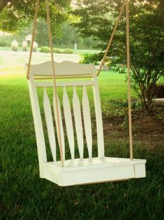 Swing made from an old chair  - DIY: remove legs, paint, drill holes and thread rope through. For the porch!!