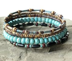 Beaded bracelet stack - Turquoise & brown bangles wrap around your wrist 5 times in one continuous coil. Turquoise dyed magnesite stones combine with Turquoise Jewelry, Boho Jewelry, Turquoise Bracelet, Beaded Jewelry, Jewelery, Jewelry Bracelets, Jewelry Design, Fashion Jewelry, Stacking Bracelets