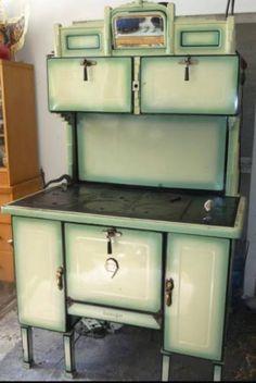Art Deco wood burning cook stove by Belanger, manufactured in Montreal, Quebec in 1947. Fantastic Art Deco details, 6 burners, 2 warming compartments, oven, original hardware, new fire bricks.