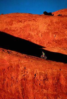 Caren Mapes rides the Lion's Back sandstone ridge at Slickrock, in #Moab, Utah. #mtb #mountainbiking #travel