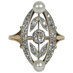 "1910s Diamond Pearl Gold Platinum Marquise Ring. Antique ""Marquise"" ring in 18k yellow platinum set with rose cut and brillant cut diamonds (total weight approx. 1 ct) decorated with 2 fine pearls.  Circa 1910."