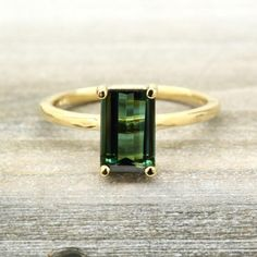Our Máire necklace is part of our one of a kind collection. This natural 1.44 ct forest green emerald cut tourmaline has a rich lustrous deep green color that i