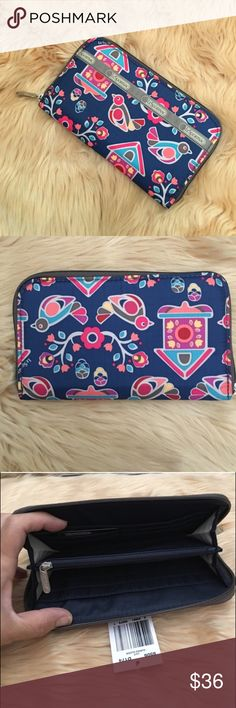 LeSportsac Wallet - Cuckoo Clock Zipped main closure. Front open pocket. 8 credit card slots. Zipped center divider coin pocket. Full-length bill compartment.  4.25 x 7.5 x 0.75 in. 🔴PRICE FIRM UNLESS BUNDLED🔴 LeSportsac Bags Wallets