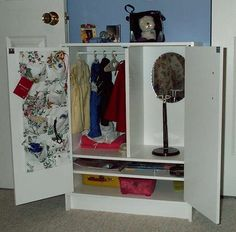 Make it! Diy American Girl clothing storage from a Closetmaid cabinet. Can sit or stand dolls on top.