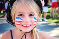 Judith Barnett, The Future of the Fourth , This picture was taken of my granddaughter by my daughter at the annual 4th of July parade in Brewster, MA.  my granddaughter (and her sister) are the future, full of patriotism, enthusiasm, and joy.  I believe her smile and spirit epitomizes the best of the American Moment.