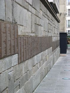 """Le Mur des Justes - Mémorial de la Shoah, Paris. The Wall of the Righteous (Le Mur des Justes) lists the full names of the """"Righteous among the Nations"""" -- those persons who during 1939-45 helped rescue Jews from extermination -- and the place of their deeds. 21,310 names were on the wall as of 2008, including 2,693 France citizens."""