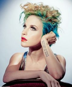 She looks very pretty in this photo I love the blue in her hair. Awesome :D