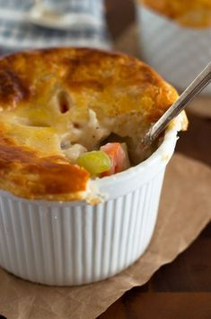 These Individual Chicken Pot Pies are easy to make, stuffed with chicken, carrots, and celery, and topped with a delicious flaky buttermilk crust. Chicken pot pie is one of my favorite meals. It's everything warm Single Serve Meals, Single Serving Recipes, Single Serving Chicken Pot Pie Recipe, Easy Dinners For Two, Meals For One, Small Meals, Hash Browns, Ramen, Mini Pot Pies